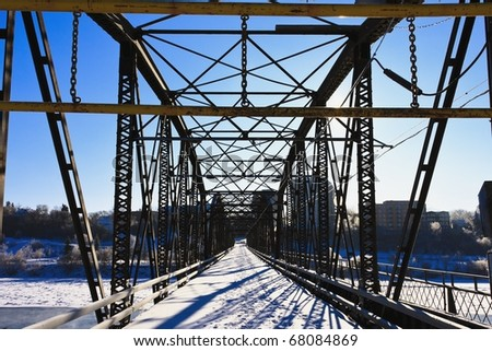 Victoria Bridge over the icy South Saskatchewan River in the city of Saskatoon, Canada