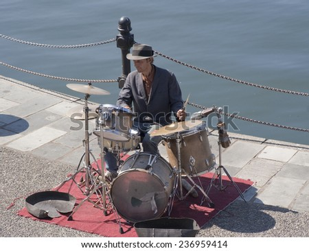 VICTORIA, CANADA - AUGUST 2, 2005: Street Musician playing the drums on the quay of the Inner Harbour of Victoria, Canada. The Inner Harbour is a lively area filled with artisans. - stock photo