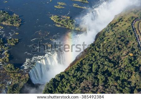 Victoria Falls and rainbow in Zimbabwe - stock photo