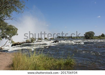 Victoria falls en to the border of the Zimbabwe  - stock photo