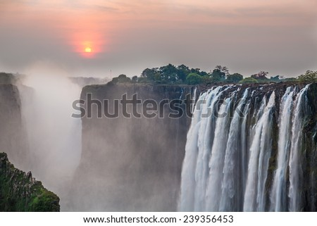 Victoria Falls sunset with red sun, View from Zambia