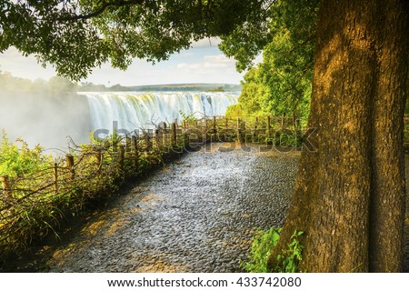 Victoria Falls waterfall in Africa, between Zambia and Zimbabwe, one of the seven wonders of the world - stock photo