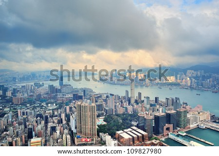 Victoria Harbor aerial view and skyline in Hong Kong with urban skyscrapers. - stock photo