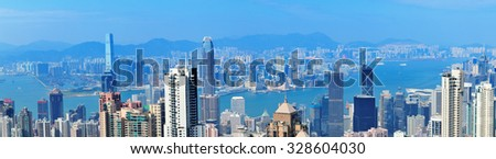 Victoria Harbor aerial view with Hong Kong skyline and urban skyscrapers in the day. - stock photo