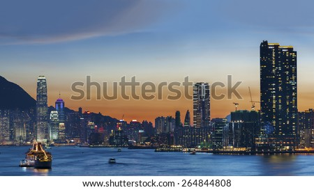 Victoria Harbor of Hong Kong under sunset - stock photo