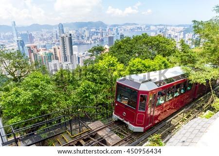 Victoria Peak Tram and Hong Kong city skyline - stock photo