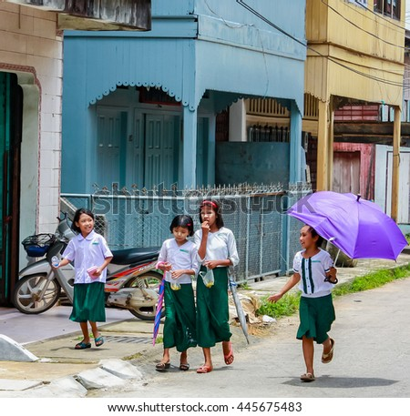Victoria Point, Myanmar- August 8, 2012 : Myanma student back home from school. Lifestyle of Myanmar student still wear sarong.