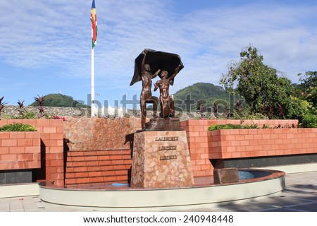 VICTORIA, SEYCHELLES-DEC. 13, 2014:  Designed and built by sculptor Tom Bowers, the Liberty Monument commemorates  independence from Britain in 1976. - stock photo