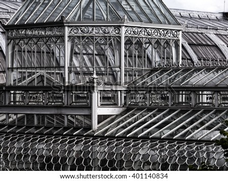Victorian glass house; victorian glass and cast-iron greenhouse or palm house or orangery  - stock photo