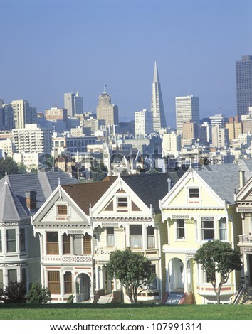 Victorian House District, Steiner Street, with downtown San Francisco in background - stock photo