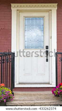 Victorian house with vintage wooden white door.