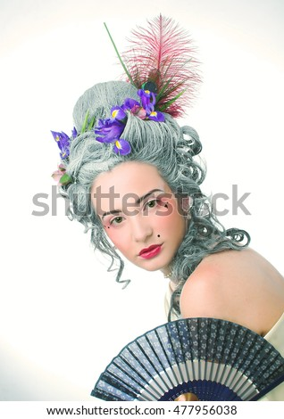 Victorian lady. Young woman in eighteenth century image posing with fan