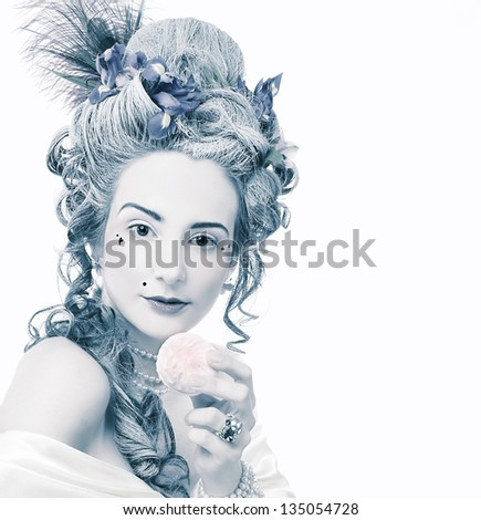 Victorian lady. Young woman in eighteenth century image posing with sweets