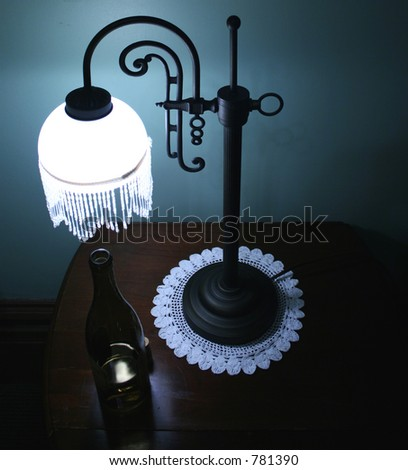 Victorian Lamp with Wine Bottle - stock photo