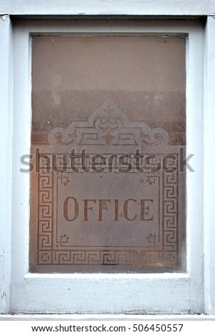 Victorian office sign etched onto a window