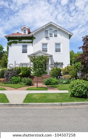 Victorian Suburban Three Story Home Landscaped Front Yard Sidewalk Blacktop Street Residential Neighborhood - stock photo