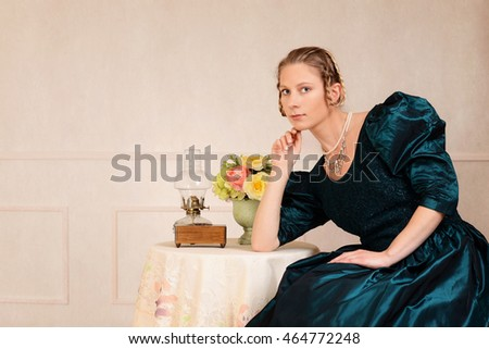 victorian woman leaning on table