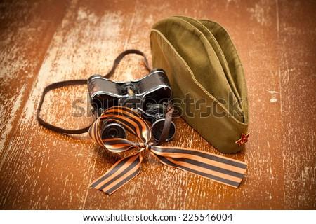 Victory Day on May 9. binoculars, field cap, George Ribbon - stock photo