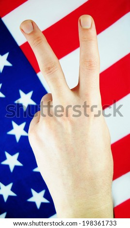 Victory sign against the US flag