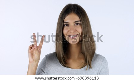 Victory Sign by Girl, White Background in Studio