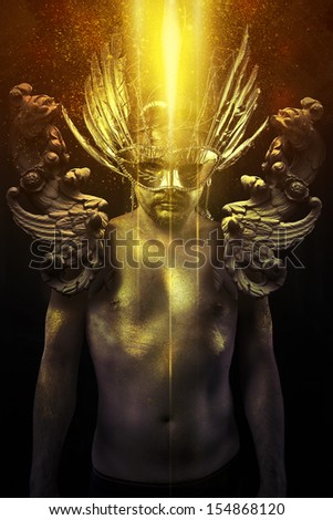 Victory, warrior or ancient god with golden mask and sword greatsword