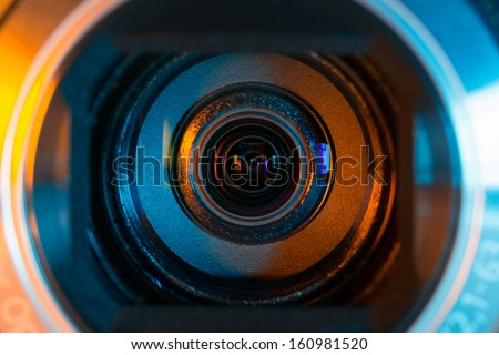 Video camera lens closeup - stock photo