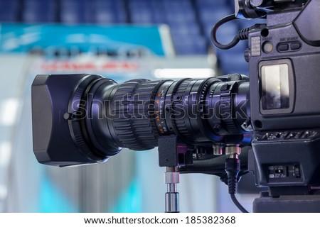 Video camera lens - recording show in TV studio - focus on camera aperture - stock photo