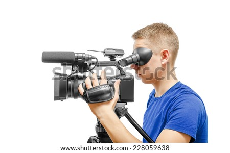 Video camera operator working with his professional equipment isolated on white background - stock photo