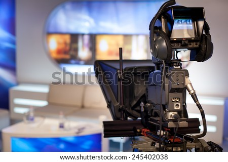 Video camera - recording show in TV studio - focus on camera - stock photo