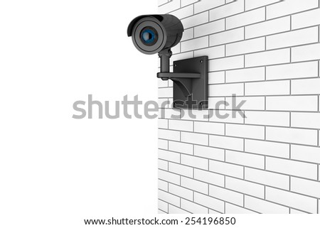 Video Camera Security System over Brick Wall on a white background - stock photo