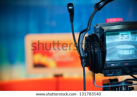 Video camera viewfinder - recording show in TV studio - focus on camera - stock photo