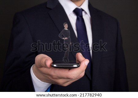 video conference concept - business man holding smart phone with woman proection