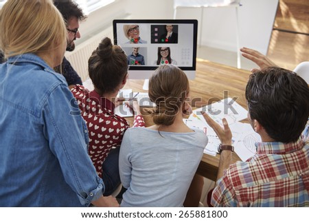 Video conference with co-workers from abroad - stock photo