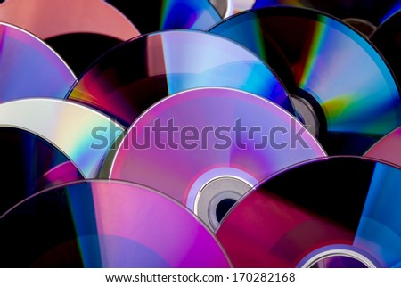 video discs form a colored background - stock photo