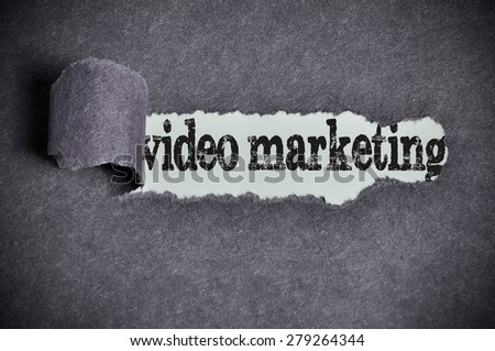 video marketing word under torn black sugar paper. - stock photo