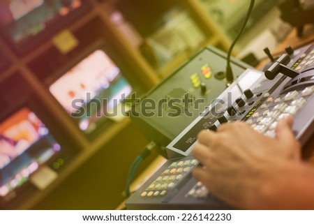 Video mixing panel in a television studio - stock photo