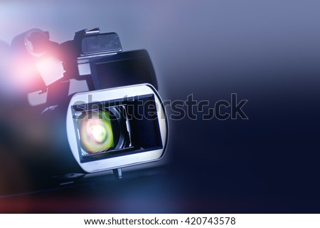 Video Motion Picture Background with Modern Digital Motion Picture Video Camera - stock photo