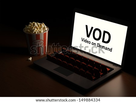 Video on  Demand. Laptop as an cinema. Home entertainment. View the video by subscription. - stock photo