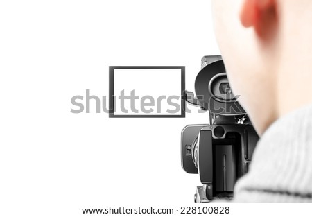 Video operator is shooting on video. Rear view. - stock photo
