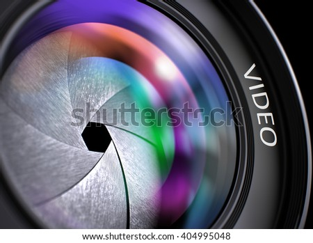 Video Written on a Front Glass of Camera Lens. SLR Camera Lens with Video Concept, Closeup. Lens Flare Effect. Lens of Camera with Video Inscription. Colorful Lens Flares on Front Glass. 3D.