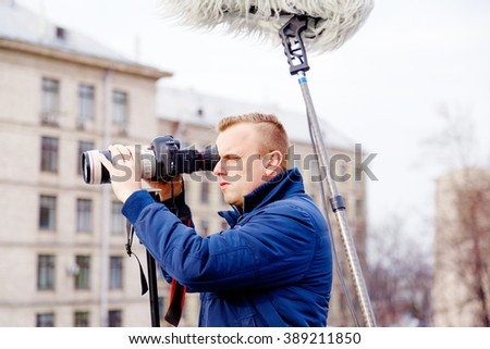 videographer in the street - stock photo