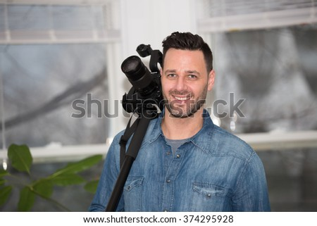Videographer working at home.  - stock photo