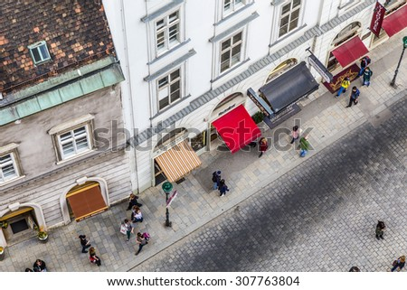 VIENNA - APR 24, 2015: aerial of crowded Stephansplatz in Vienna, Austria. Severalpopular pedestrian routes begin here and a lot of tourists visit this place. - stock photo