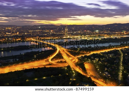 Vienna at night with Danube River & Island (Donauinsel) and highway junction.