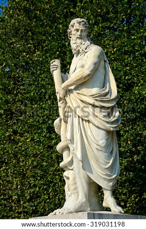 VIENNA - AUGUST 10 : Statue of Asclepius at Schonbrunn Palace at 21 August 2015 in Vienna, Austria. Schonbrunn is the former home of the Habsburgs. - stock photo
