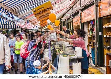 VIENNA, AUSTRIA - APR 28, 2015: people enjoy the Naschmarket in Vienna. Since the 16th century people in Austria has come to the Naschmarkt get to enjoy the many different products from local producer - stock photo