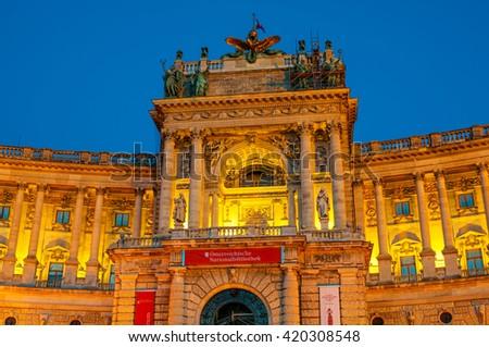VIENNA, AUSTRIA - APRIL 24, 2016: Austrian National Library and the Hofburg Congress Center on Heldenplatz in Hofburg in evening - stock photo