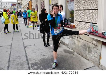 VIENNA, AUSTRIA - APRIL 10, 2016: Female runner informs about her result at the Vienna City Marathon , April 10, 2016 in Vienna, Austria. - stock photo