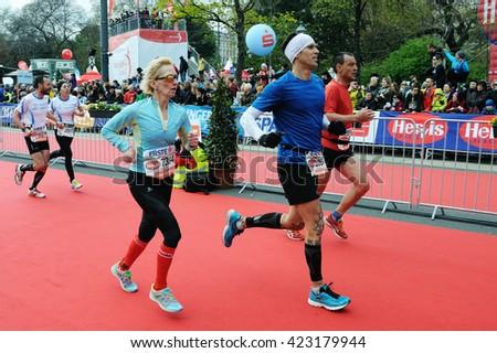 VIENNA, AUSTRIA - APRIL 10, 2016: Group of runners finishes the Vienna City Marathon , April 10, 2016 in Vienna, Austria. - stock photo
