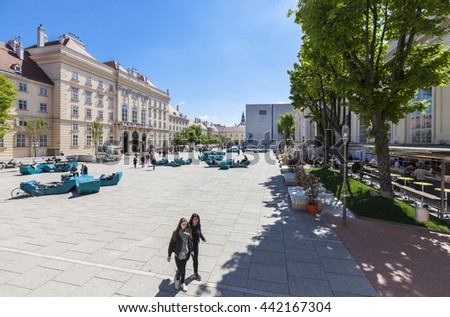 VIENNA, AUSTRIA - APRIL 29, 2016: Many people enjoy a sunny afternoon at the Museumsquartier in Vienna. It is the eighth largest cultural area in the world. - stock photo